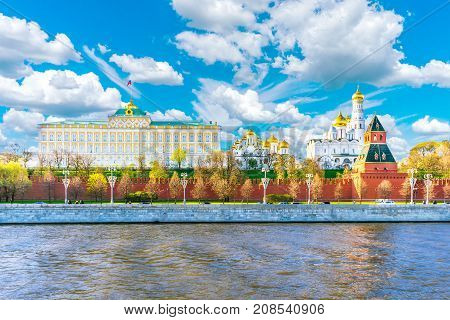 Moscow Kremlin. Grand Kremlin Palace. The bell tower of Ivan the Great and the Annunciation Cathedral in the Moscow Kremlin. Moscow Kremlin against the background of a cloudy sky
