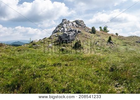 mountain meadow with few rocks and stones and blue sky with clouds on Skalky hill in Mala Fatra mountains in Slovakia