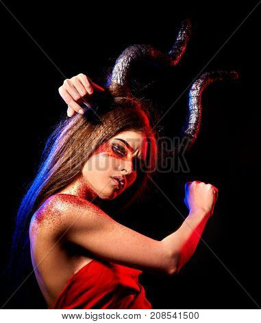 Black magic ritual of mad satan woman cry in hell on Halloween. Witch reincarnation mythical creature on Sabbath. Devil absorbing soul. Mythical zodiac Horoscope, Taurus astrology. Astral entities.
