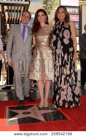 LOS ANGELES - OCT 6:  Debra Messing, Max Mutchnick, Mariska Hargitay at the Debra Messing Star Ceremony at the Hollywood Walk of Fame on October 6, 2017 in Los Angeles, CA