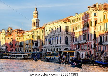 VENICE,ITALY - JULY 25,2017 : Gondolas and vaporetti on the Grand Canal in Venice surrounded by old palaces
