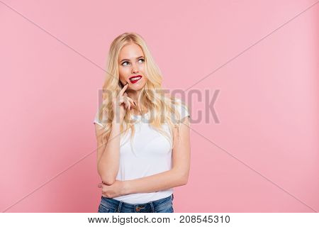 Picture of sly mystery woman looking away over pink background
