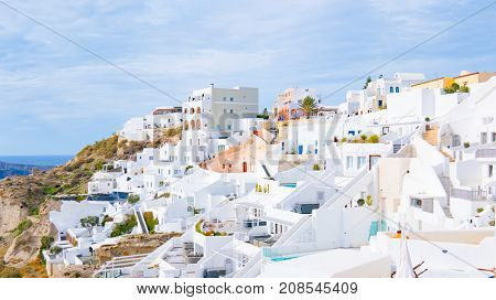 Panorama ofOia town on Santorini island, Greece. Traditional and famous white and rose  houses over the Caldera, Aegean sea