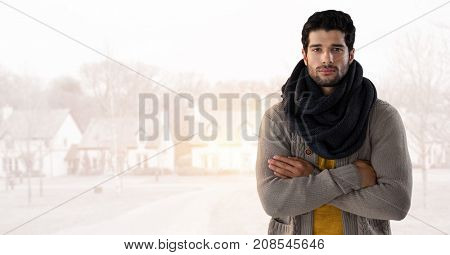 Digital composite of Man in Autumn with  with scarf and folded arms in bright housing estate