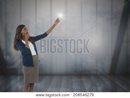 Digital composite of Businesswoman pointing by windows