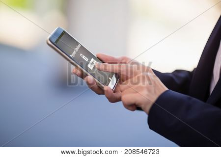 Payment declined text on mobile display against businesswoman using mobile phone