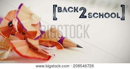 Back to school text over white background against close-up of pencil with shavings