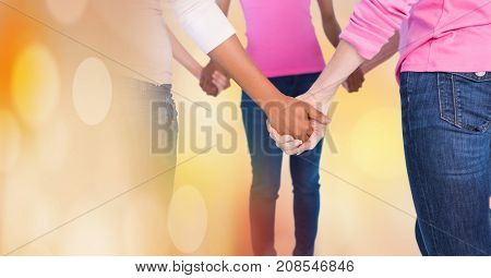 Digital composite of Breast cancer women with transition holding hands