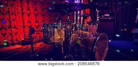 Flying colours against drum kit in music studio