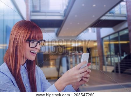 Digital composite of Woman holding phone in building