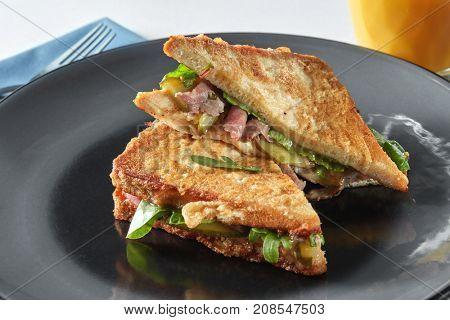 Italian ciabatta sandwich with parma ham and herbs