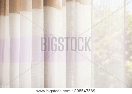Beautiful silk curtains in room, closeup