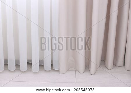 Beautiful silk curtains in room