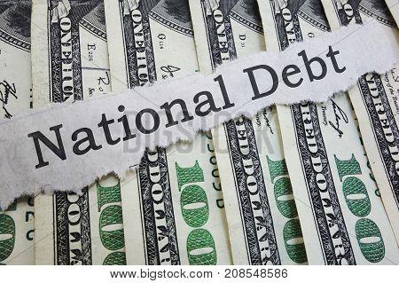 National Debt news headline on hundred dollar bills