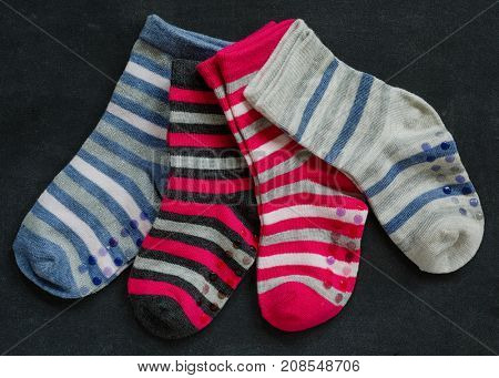 Various colors of child's striped socks.