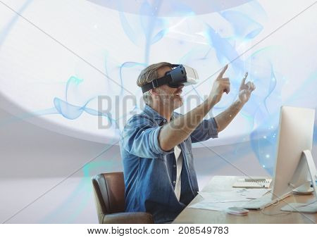 Digital composite of happy man with vr headset at desk