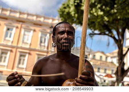 Man playing Capoeira in Salvador, Bahia, Brazil