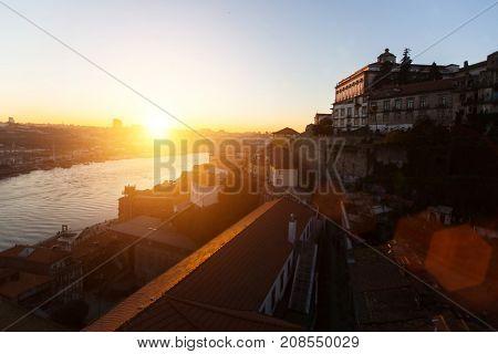 Douro river and Ribeira at amazing sunset, Porto, Portugal.