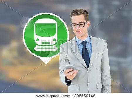 Digital composite of Man holding phone with train icon in city