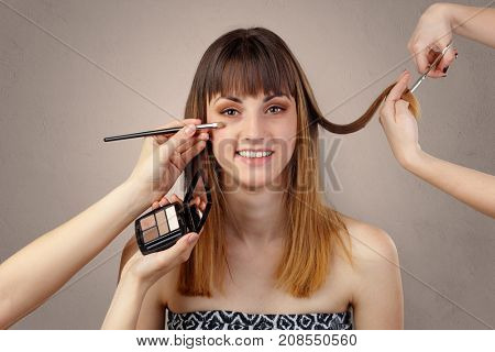 Portrait of young pretty woman at beautician and hairdresser