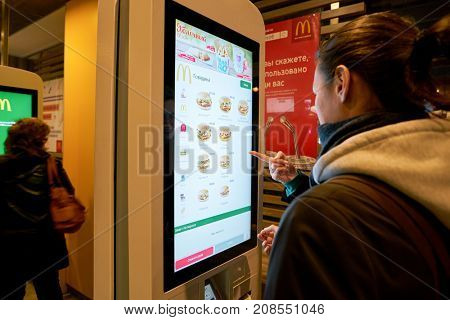 SAINT PETERSBURG, RUSSIA - CIRCA OCTOBER, 2017: ordering kiosk at McDonald's restaurant. McDonald's is an American hamburger and fast food restaurant chain.