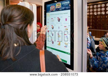 SAINT PETERSBURG, RUSSIA - CIRCA SEPTEMBER, 2017: ordering kiosk at McDonald's restaurant. McDonald's is an American hamburger and fast food restaurant chain.