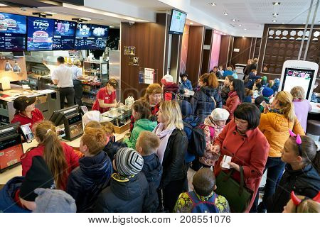 SAINT PETERSBURG, RUSSIA - CIRCA SEPTEMBER, 2017: people queue at a McDonalds's restaurant. McDonald's is an American hamburger and fast food restaurant chain.