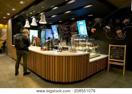 SAINT PETERSBURG, RUSSIA - CIRCA OCTOBER, 2017: counter service in a McCafe coffee shop. McCafe is a coffee-house-style food and beverage chain, owned by McDonald's.