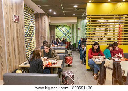 SAINT PETERSBURG, RUSSIA - CIRCA OCTOBER, 2017: people at McDonald's in Saint Petersburg. McDonald's is an American hamburger and fast food restaurant chain.
