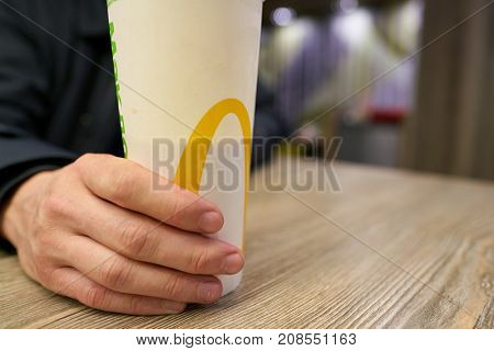 SAINT PETERSBURG, RUSSIA - CIRCA OCTOBER, 2017: close up shot of a cup at a McDonald's restaurant in Saint Petersburg. McDonald's is an American hamburger and fast food restaurant chain.