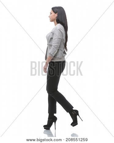 full-length. side view. modern young woman confidently goes forward