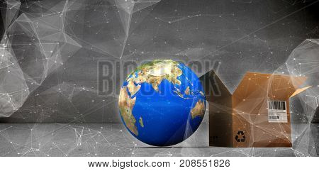 World map and brown box against abstract black background