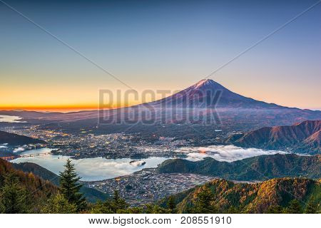 Mt. Fuji, Japan over Kawaguchi Lake on an autumn dawn.