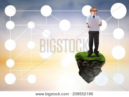 Digital composite of Young boy on floating rock platform  in sky holding card with connectors interface mind map