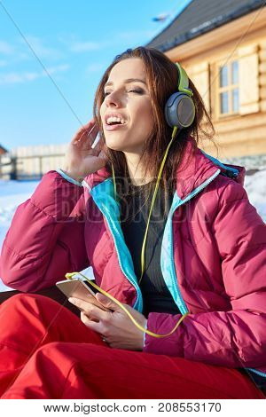 Happy Winter Woman With Headphones - Beautiful girl listening to music outside