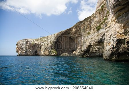 Malta cliffs at Blue Grotto from sea level