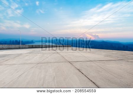 empty marble floor and cityscape of chongqing in cloud sky