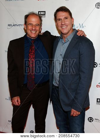 Director Michael Hoffman (L) and author Nicholas Sparks attend