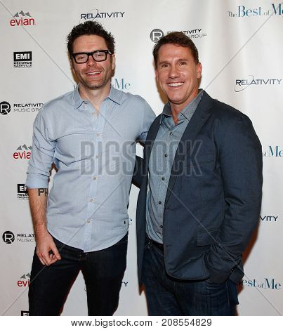 Radio host Bobby Bones (L) and author Nicholas Sparks attend