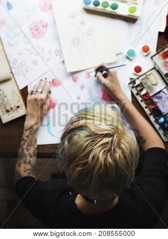 Rear View of Artist Woman Working Painting Flowers Water Color on Papers