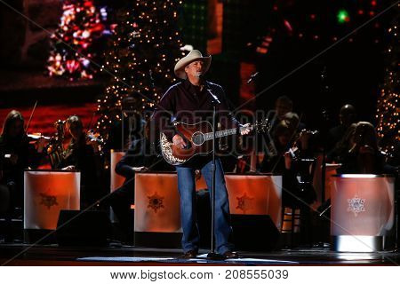 NASHVILLE, TN-NOV Recording artist Alan Jackson performs at the 2014 CMA Country Christmas at the Bridgestone Arena on November 7, 2014 in Nashville, Tennessee.