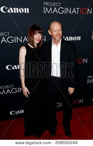 NEW YORK- OCT 24: Bryce Dallas Howard (L) and Ron Howard attend the global premiere of Canon's