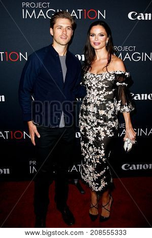 NEW YORK- OCT 24: Actor Aaron Tveit (L) and Georgina Chapman attend the global premiere of Canon's