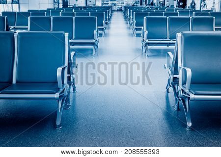 row of empty blue seats in airport lobby,china.