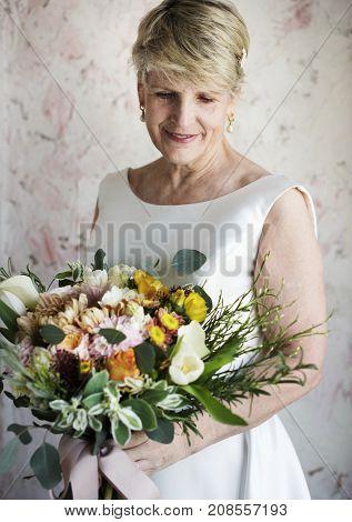 Senior Caucasian Bride Holding Flower Bouquet Wedding Engagement Ceremony