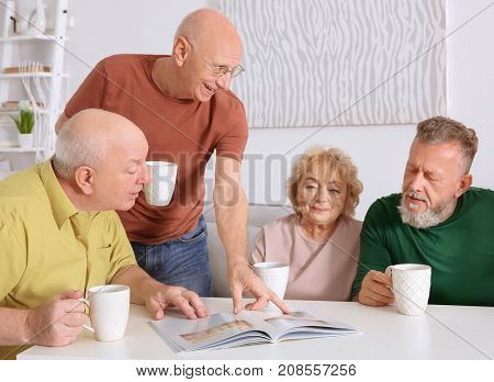 Group of elderly people resting at home