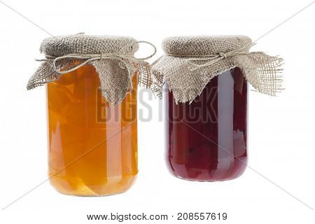 Homemade berry jams in jar isolated on white background.