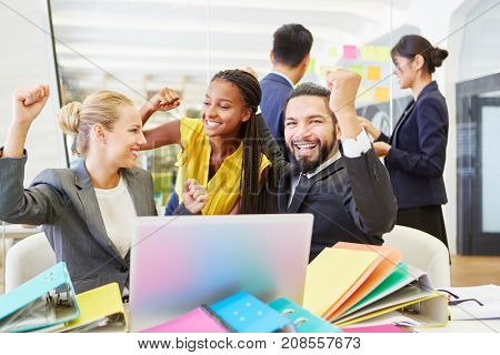 Successful start-up team celebrating together at work