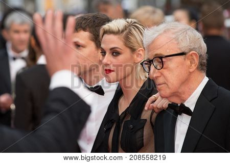 CANNES, FRANCE - MAY 11, 2016: J. Eisenberg,  K. Stewart, W. Allen attend the 'Cafe Society' premiere and the Opening Night Gala. 69th annual Cannes Film Festival at the Palais des Festivals