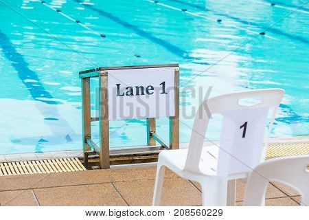 swimming lane 1 sign posted at a school swimming competition